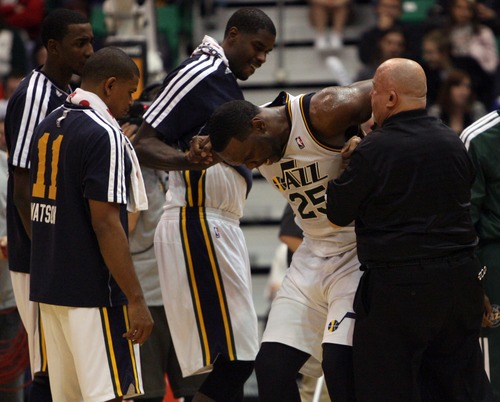 Kim Raff  |  The Salt Lake Tribune Utah Jazz center Al Jefferson (25) is helped off of the court after being injured during a game against Orlando at EnergySolutions Arena in Salt Lake City on December 5, 2012. Jazz went on to win 87-81.