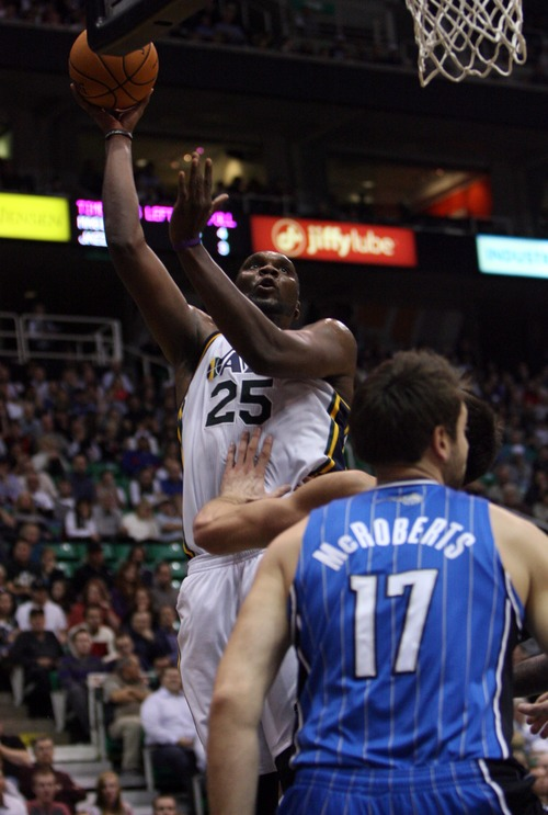 Kim Raff  |  The Salt Lake Tribune (left) Utah Jazz center Al Jefferson (25) takes a shot over the head of (right) Orlando Magic power forward Josh McRoberts (17) during a game at EnergySolutions Arena in Salt Lake City on December 5, 2012. Jazz went on to win 87-81.