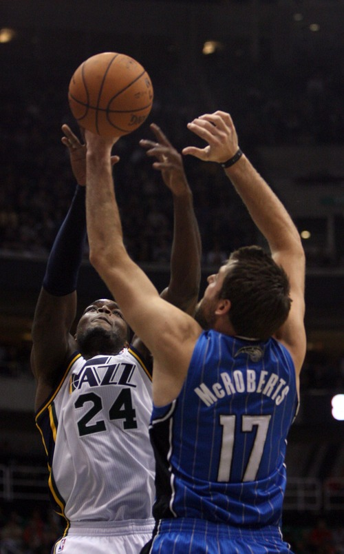 Kim Raff     The Salt Lake Tribune Utah Jazz power forward Paul Millsap (24) and Orlando Magic power forward Josh McRoberts (17) compete for a rebound during a game at EnergySolutions Arena in Salt Lake City on December 5, 2012. Jazz went on to win 87-81.