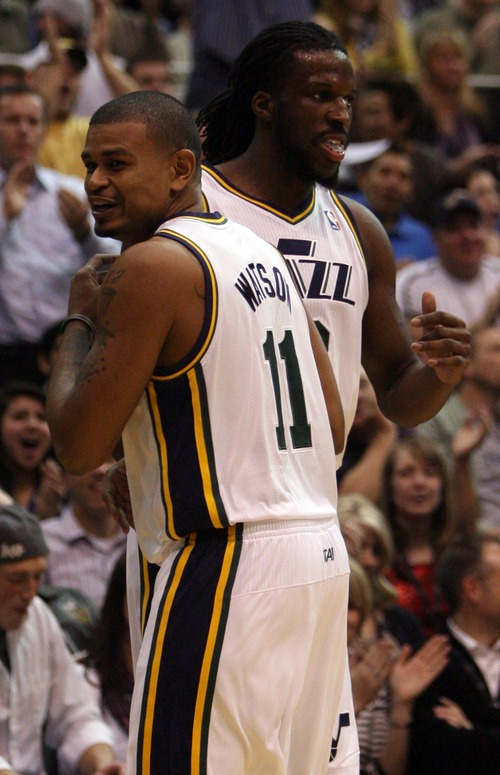 Kim Raff  |  The Salt Lake Tribune (back) Utah Jazz small forward DeMarre Carroll (3) and Utah Jazz point guard Earl Watson (11) celebrate Carroll turning over the ball and drawing a foul during a game against Orlando at EnergySolutions Arena in Salt Lake City on December 5, 2012. Jazz went on to win 87-81.