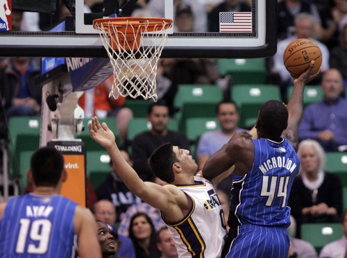 Kim Raff  |  The Salt Lake Tribune (left) Utah Jazz center Enes Kanter (0) defends Orlando Magic power forward Andrew Nicholson (44) as he takes a shot during a game at EnergySolutions Arena in Salt Lake City on December 5, 2012. Jazz went on to win 87-81.