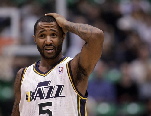 Kim Raff     The Salt Lake Tribune Utah Jazz point guard Mo Williams (5) recovers from being elbowed in the head during a game against Orlando at EnergySolutions Arena in Salt Lake City on December 5, 2012. Jazz went on to win 87-81.