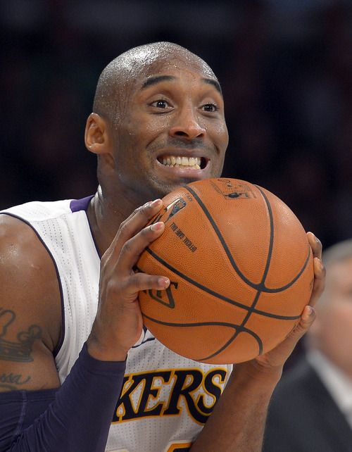 Los Angeles Lakers guard Kobe Bryant reacts to a call that went against the them during the first half of their NBA basketball game against the Utah Jazz, Sunday, Dec. 9, 2012, in Los Angeles. (AP Photo/Mark J. Terrill)