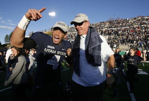 Scott Sommerdorf  |  The Salt Lake Tribune               Utah State senior WR Matt Austin celebrates with his head coach Gary Andersen after the win over Idaho on Nov. 24, 2012 to become champions of the WAC.