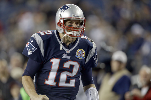 New England Patriots quarterback Tom Brady runs onto the field before an  NFL football game between the Patriots and the Houston Texans in Foxborough, Mass., Monday, Dec. 10, 2012. (AP Photo/Elise Amendola)