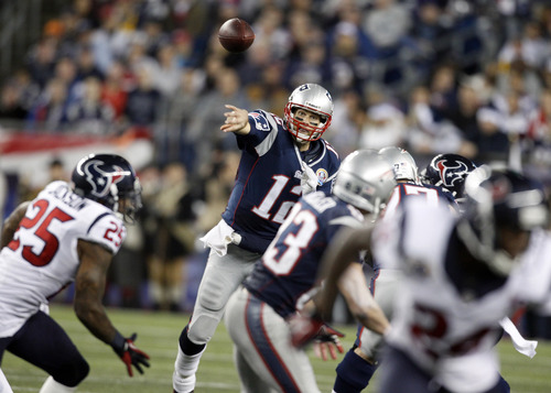 New England Patriots quarterback Tom Brady (12) passes against the Houston Texans during the third quarter of an NFL football game in Foxborough, Mass., Monday, Dec. 10, 2012. (AP Photo/Stephan Savoia)