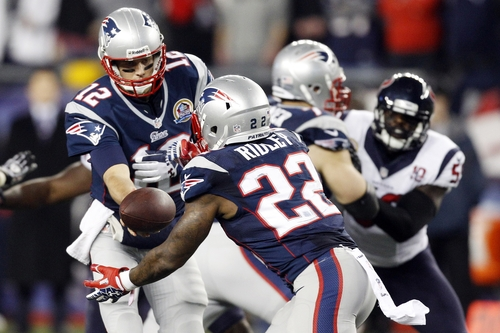 New England Patriots quarterback Tom Brady (12) hands off to running back Stevan Ridley (22) during the first quarter of an NFL football game against the Houston Texans in Foxborough, Mass., Monday, Dec. 10, 2012. (AP Photo/Stephan Savoia)