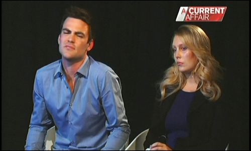 """In this image made off video footage recorded Monday, Dec. 10, 2012 and aired later in the day in """"A Current Affair"""" program by Australia's Channel Nine, Australian radio DJs Michael Christian, left, and Mel Greig appear during an interview with the TV station. The two managed to impersonate Queen Elizabeth II and Prince Charles and received confidential information about the Duchess of Cambridge's medical condition, which was broadcast on-air. The controversial prank took a dark twist three days later with the death of nurse Jacintha Saldanha, a 46-year-old mother of two, who was duped by the DJs despite their Australian accents. (AP Photo/Channel Nine) AUSTRALIA OUT, TV OUT, NO SALES, EDITORIAL USE ONLY"""