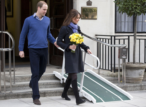 FILE- In this Thursday, Dec. 6, 2012 file photo, Britain's Prince William stand next to his wife Kate, Duchess of Cambridge as she leaves the King Edward VII hospital in central London. Prince William and his wife Kate are expecting their first child, and the Duchess of Cambridge was admitted to hospital suffering from a severe form of morning sickness in the early stages of her pregnancy.  King Edward VII hospital says a nurse involved in a prank telephone call to elicit information about the Duchess of Cambridge has died. The hospital said Friday, Dec. 7, 2012 that Jacintha Saldanha had been a victim of the call made by two Australian radio disc jockeys. They did not immediately say what role she played in the call.   (AP Photo/Alastair Grant, File)