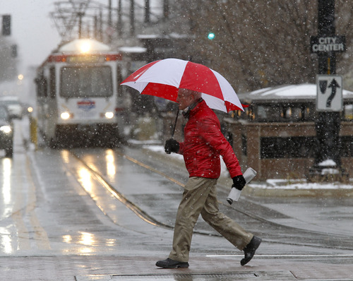 Al Hartmann  |  The Salt Lake Tribune Man hurries  across Main Street in Salt Lake City during noon's cold and snowy weather Monday Dec. 10.