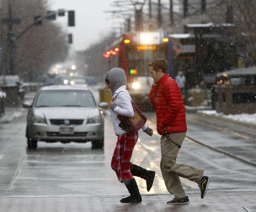 Al Hartmann  |  The Salt Lake Tribune People scurry across Main Street in Salt Lake City during noon's cold and snowy weather Monday Dec. 10.