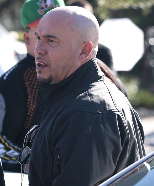 Gustavo Rivera, right, brother of singer Jenni Rivera, arrives at his mother's home in Lakewood, Calif. Monday, Dec. 10, 2012. Jenni Rivera died Sunday in a plane crash in Mexico. (AP Photo/Jason Redmond)
