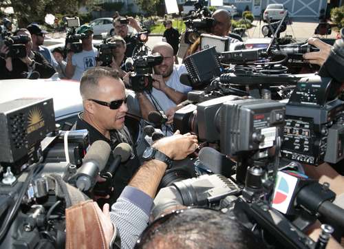 Pedro Rivera, Jr., left, brother of singer Jenni Rivera, is interviewed by media as he arrives at his mother's home in Lakewood, Calif. Monday, Dec. 10, 2012. Jenni Rivera died Sunday in a plane crash in Mexico. (AP Photo/Jason Redmond)