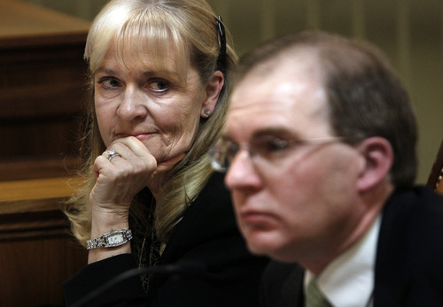 Scott Sommerdorf  |  The Salt Lake Tribune              Rep. Christine Watkins, D, Price, listens to testimony from adoption attorney Dave Hardy in a committee meeting about HB308, Thursday February 9, 2012. Hardy opposed the bill.