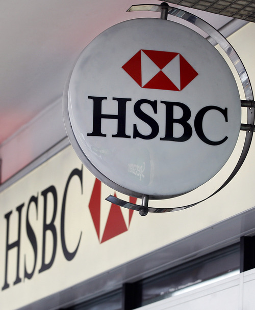 FILE This is a Monday, Feb. 27, 2012 file photo of  the logo is seen on a branch of HSBC bank in London.  HSBC avoided a legal battle that could further savage its reputation and undermine confidence in the global banking system by agreeing Tuesday Dec. 11, 2012 to pay $1.9 billion to settle a U.S. money-laundering probe. Europe's largest bank by market value will pay the biggest penalty ever imposed on a bank after facing accusations it transferred funds through the U.S. from Mexican drug cartels and on behalf of nations such as Iran that are under international sanctions. (AP Photo/Kirsty Wigglesworth, File)