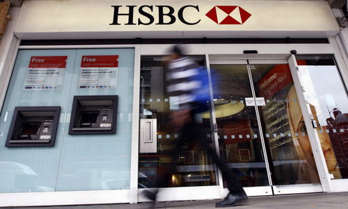 FILE This is a Monday, Feb. 27, 2012 file photo of  a pedestrian passes a branch of HSBC bank in London.  HSBC avoided a legal battle that could further savage its reputation and undermine confidence in the global banking system by agreeing Tuesday Dec. 11, 2012 to pay $1.9 billion to settle a U.S. money-laundering probe. Europe's largest bank by market value will pay the biggest penalty ever imposed on a bank after facing accusations it transferred funds through the U.S. from Mexican drug cartels and on behalf of nations such as Iran that are under international sanctions. (AP Photo/Kirsty Wigglesworth, File)