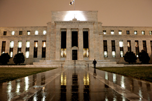 "FILE- This March 27, 2009, file photo, shows the Federal Reserve Building on Constitution Avenue in Washington. With an eye on the ""fiscal cliff,"" the Federal Reserve is expected to announce a new bond-buying plan to support the U.S. economy on Tuesday, Dec. 11, 2012. (AP Photo/J. Scott Applewhite, File)"