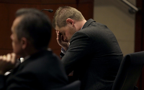 KERA WILLIAMS  |  Pool/Standard-Examiner Skyler Shepherd covers his face during his trial at the 2nd District Courthouse in Ogden on Monday, December 10, 2012.