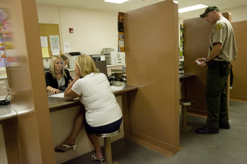 Kim Raff | The Salt Lake Tribune Pretrial jail screener Stephanie Warden checks the background of a woman who was recently brought into the Salt Lake County Jail to see if she qualifies for pretrial release.