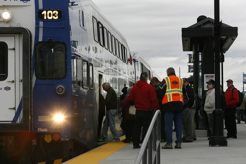 Scott Sommerdorf     The Salt Lake Tribune               Riders board the FrontRunner train in Salt Lake City for the free ride to Provo, Saturday, December 8, 2012. The public was invited to ride the new FrontRunner line linking Provo and Salt Lake City starting at 10 a.m.