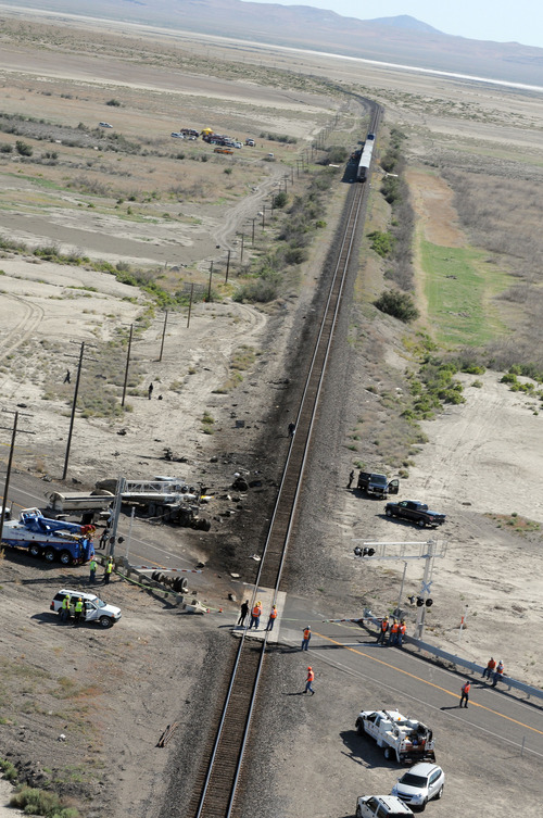 The wreckage of a truck is seen at right at the site of a collision between an Amtrak westbound train and a truck on  U.S. 95 about 4 miles south of Interstate 80 on Friday, June 24, 2011, 70 miles east of Reno, Nev.  (AP Photo/The Reno Gazette-Journal, Marilyn Newton)