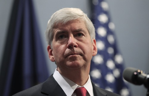 Gov. Rick Snyder speaks at a news conference in Lansing, Mich., Tuesday, Dec. 11, 2012. Michigan became the 24th state with a right-to-work law after Snyder signed the bill Tuesday. (AP Photo/Carlos Osorio)