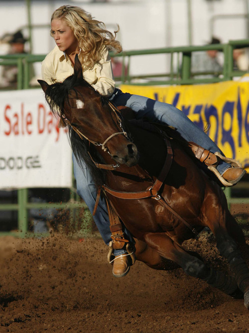 Heber City - Chenae Shiner competes in barrel racing Utah High School Rodeo. Trent Nelson/The Salt Lake Tribune; 6.08.2007