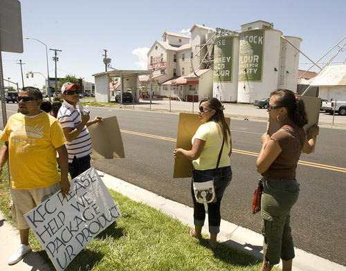 Paul Fraughton | Tribune file photo Employees of Lehi Roller Mills and family members hold signs at a demonstration across the street from the mill.   Monday, July 9, 2012