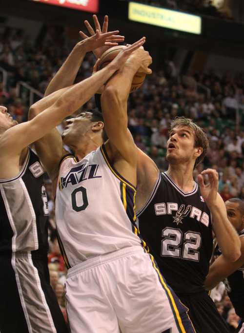 Rick Egan  | The Salt Lake Tribune   Utah Jazz center Enes Kanter (0) tries to get a shot off, as San Antonio Spurs power forward Tiago Splitter (22) and San Antonio Spurs shooting guard Manu Ginobili (20) double team him,as the Jazz faced the San Antonio Spurs, at the Energy Solutions Arena, Wednesday, December 12, 2012.