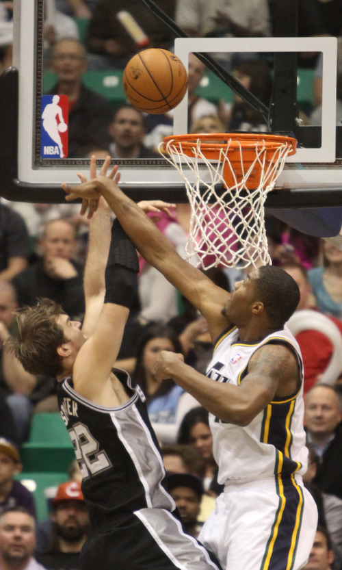 Rick Egan  | The Salt Lake Tribune   Utah Jazz power forward Marvin Williams (2) defends as San Antonio Spurs power forward Tiago Splitter (22) goes to the hoop, as the Jazz faced the San Antonio Spurs, at the Energy Solutions Arena, Wednesday, December 12, 2012.