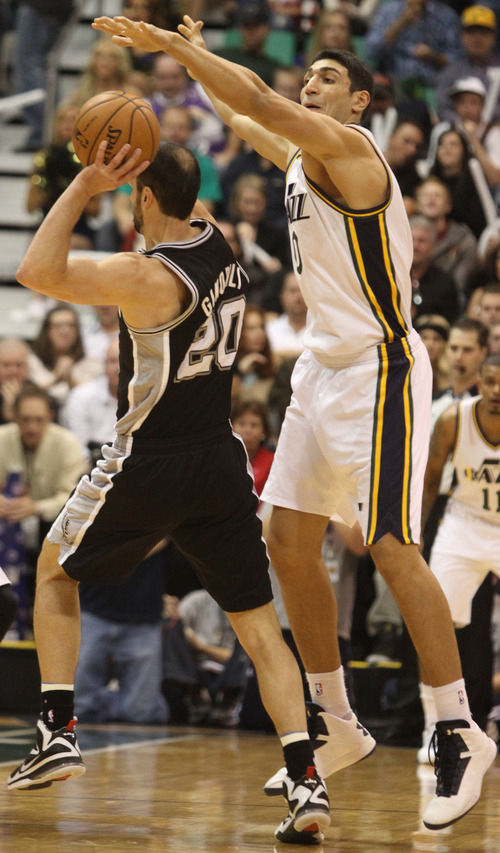 Rick Egan  | The Salt Lake Tribune   Utah Jazz center Enes Kanter (0) puts the pressure on San Antonio Spurs shooting guard Manu Ginobili (20) in NBA action, at the Energy Solutions Arena, Wednesday, December 12, 2012.