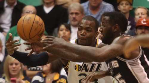 Rick Egan  | The Salt Lake Tribune   Utah Jazz power forward Paul Millsap (24) goes after a rebound along with San Antonio Spurs center DeJuan Blair (45) in NBA action, at the Energy Solutions Arena, Wednesday, December 12, 2012.