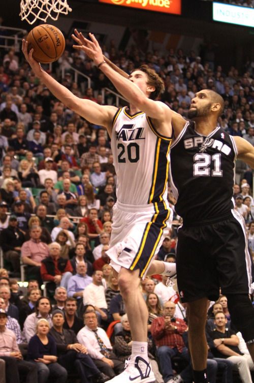 Rick Egan  | The Salt Lake Tribune   Utah Jazz shooting guard Gordon Hayward (20) goes in for a lay-up as San Antonio Spurs power forward Tim Duncan (21) defends, in NBA action, at the Energy Solutions Arena, Wednesday, December 12, 2012.