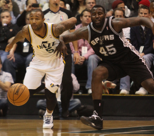 Rick Egan  | The Salt Lake Tribune   Utah Jazz point guard Mo Williams (5) and San Antonio Spurs center DeJuan Blair (45) go for a loose ball, in NBA action, at the Energy Solutions Arena, Wednesday, December 12, 2012.