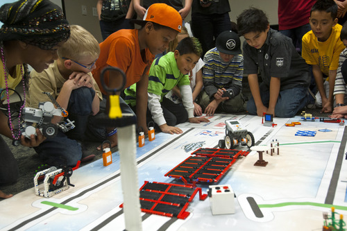 Chris Detrick  |  The Salt Lake Tribune Fourth, fifth and sixth graders from the Fremont Robo Leaders team Robo Vampires demonstrate their Lego robot designs during Granite School District's FIRST LEGO League event at the Granite Education Center Wednesday December 12, 2012.  The event showcased the talent of young engineers in their Lego robot designs and capabilities in a competitive format. The students have developed the robots and other projects through after school programs headed by technology specialists throughout the district. ]