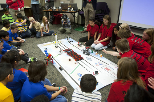 Chris Detrick  |  The Salt Lake Tribune Sixth grade students on team 'APES' (Academy Park Elementary Skyhawks) demonstrate their Lego robot designs during Granite School District's FIRST LEGO League event at the Granite Education Center Wednesday December 12, 2012.  The event showcased the talent of young engineers in their Lego robot designs and capabilities in a competitive format. The students have developed the robots and other projects through after school programs headed by technology specialists throughout the district.