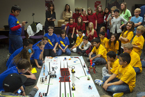 Chris Detrick  |  The Salt Lake Tribune Fifth and sixth graders on team 'Electronic Patriots' from Plymouth Elementary school demonstrate their Lego robot designs during Granite School District's FIRST LEGO League event at the Granite Education Center Wednesday December 12, 2012.  The event showcased the talent of young engineers in their Lego robot designs and capabilities in a competitive format. The students have developed the robots and other projects through after school programs headed by technology specialists throughout the district.