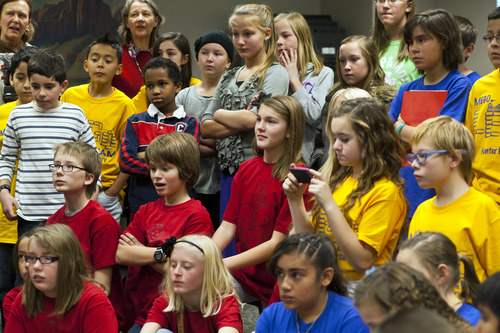 Chris Detrick  |  The Salt Lake Tribune Students watch as team 'APES' (Academy Park Elementary Skyhawks) demonstrate their Lego robot designs during Granite School District's FIRST LEGO League event at the Granite Education Center Wednesday December 12, 2012.  The event showcased the talent of young engineers in their Lego robot designs and capabilities in a competitive format. The students have developed the robots and other projects through after school programs headed by technology specialists throughout the district.