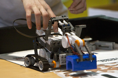 Chris Detrick  |  Tribune file photo  Artificial Intelligence's David Bore, 12, of Salt Lake City, competes during the 2011 FIRST LEGO League Championship at the University of Utah. The 2012 state championship is Jan. 28 but qualifiers begin this weekend.