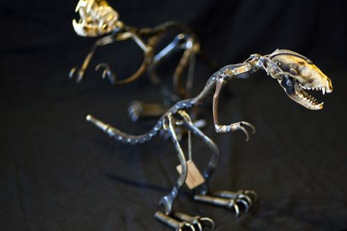 Chris Detrick  |  The Salt Lake Tribune Chupacabra Raptors made by local artist Fred Conlon of Sugarpost Metalworks for sale at the Natural History Museum of Utah on Wednesday, Dec. 5, 2012. The dinosaur sculptures are made out of found metal, including bicycle chains, wrenches, with racoon skulls.
