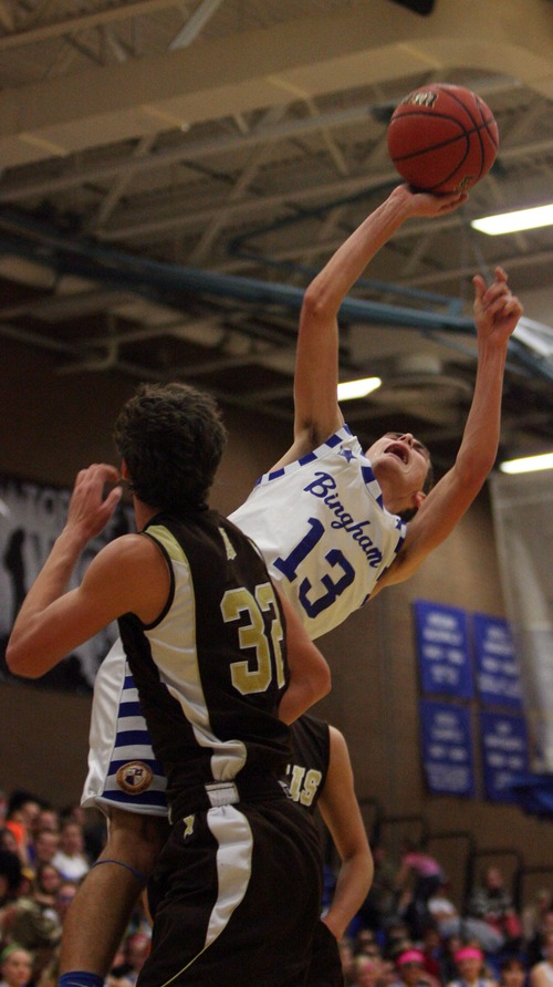 Kim Raff     The Salt Lake Tribune Davis player Braden Keolliker defends as Bingham player Jordan Evans takes a shot during a game at Bingham High School in South Jordan on December 7, 2012. Davis went on to win the game.