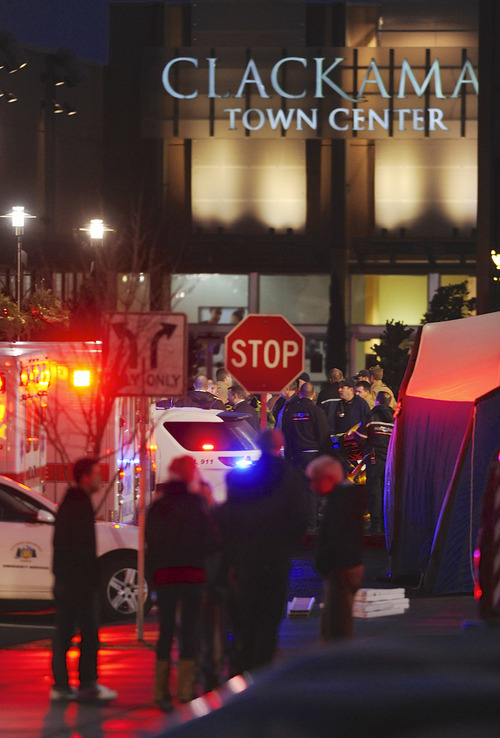 Police and medics outside the scene of a multiple shooting at Clackamas Town Center Mall in Portland, Ore., Tuesday Dec. 11, 2012. A gunman is dead after opening fire in the Portland, Ore., shopping mall Tuesday, killing two people and wounding another, sheriff's deputies said. (AP Photo/Greg Wahl-Stephens)