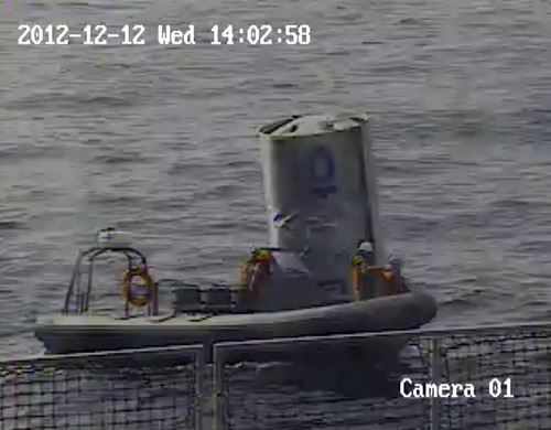 In this photo taken on Wednesday, Dec. 12, 2012, and released by the South Korean Defense Ministry via Yonhap on Thursday, Dec. 13, 2012, South Korean navy sailors carry debris from a rocket launched by North Korea, in the Yellow Sea, off Gunsan, South Korea.  The debris is believed to be a fuel container of the first stage rocket.  Defense officials said South Korea has no plans to return it to North Korea because the launch violated U.N. council resolutions. (AP Photo/South Korea Defense Ministry via Yonhap) KOREA OUT
