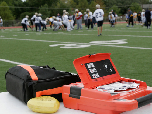 A defibrillator stands ready for use during football practice at Jesuit Preparatory High School in Dallas, Thursday, Oct. 19, 2006. The external defibrillators may not be the only heart-saving devices soon prevalent at Texas high schools. With the bulk of campuses already stocking the laptop-sized machines, some school districts are now bringing cardiac screening equipment on campus in hopes of catching congenital problems in students before clearing them to play sports. (AP Photo/Ron Heflin)