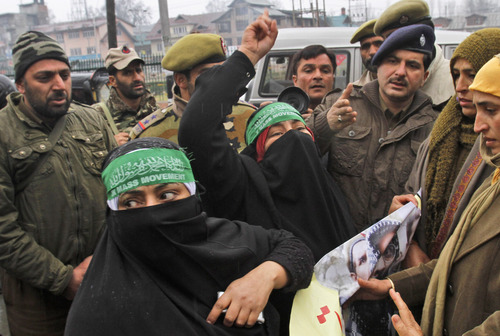 Women activists of Jammu Kashmir Mass Movement (JKMM) shout pro-freedom slogans during a protest demanding the release of all political prisoners in Srinagar, India, Thursday, Dec 13, 2012. (AP Photo/Mukhtar Khan)