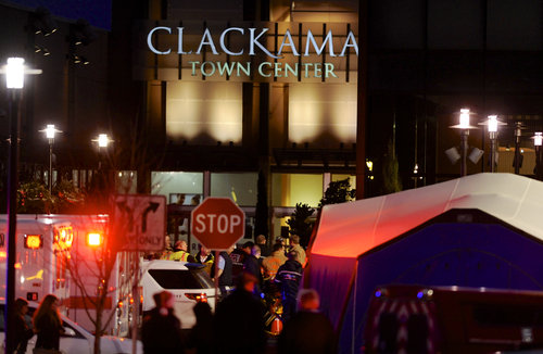Police and medics work the scene of a multiple shooting at Clackamas Town Center Mall in Portland, Ore., Tuesday Dec. 11, 2012. A gunman is dead after opening fire in the Portland, Ore., area shopping mall Tuesday, killing two people and wounding another, sheriff's deputies said. (AP Photo/Greg Wahl-Stephens)