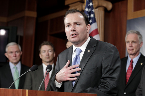 File -- Sen. Mike Lee, R-Utah, second from right.  (AP Photo/J. Scott Applewhite)