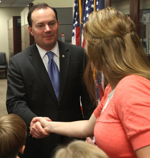Rick Egan  | The Salt Lake Tribune   Senator Lee welcomes visitors from Utah to his office in the Senate office building on Capitol Hill, on Tuesdays, where he also serves them small cups of Jello, before having his photo taken with them. Wednesday, June 6, 2012.