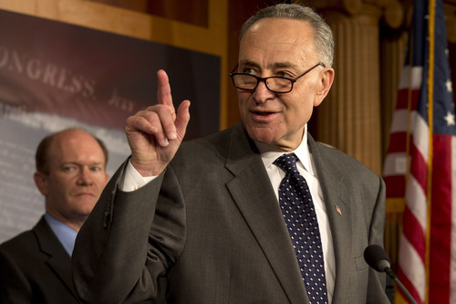 "Sen. Charles Schumer, D-N.Y., right, accompanied by Sen. Chris Coons, D-Del., gestures during a news conference on Capitol Hill in Washington, Thursday, Dec. 6, 2012, to discuss efforts to ""boost the economy and prevent Americans from abruptly losing their jobless benefits at the end of the year."" (AP Photo/Jacquelyn Martin)"
