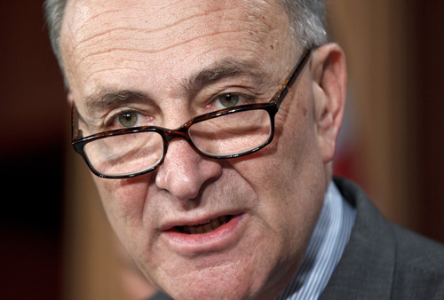 FILE -Sen. Charles Schumer, D-N.Y., invited Sen. Mike Lee, R-Utah, to be part of the group trying to come up with comprehensive immigration reform.  (AP Photo/J. Scott Applewhite, File)